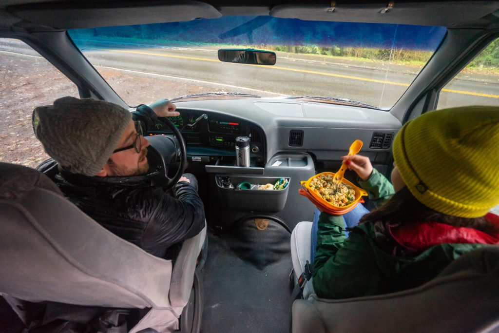 People in a car eating