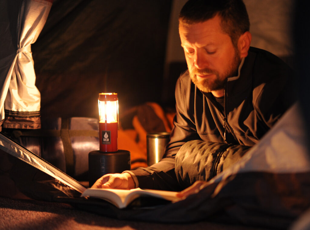 man reading by candle light