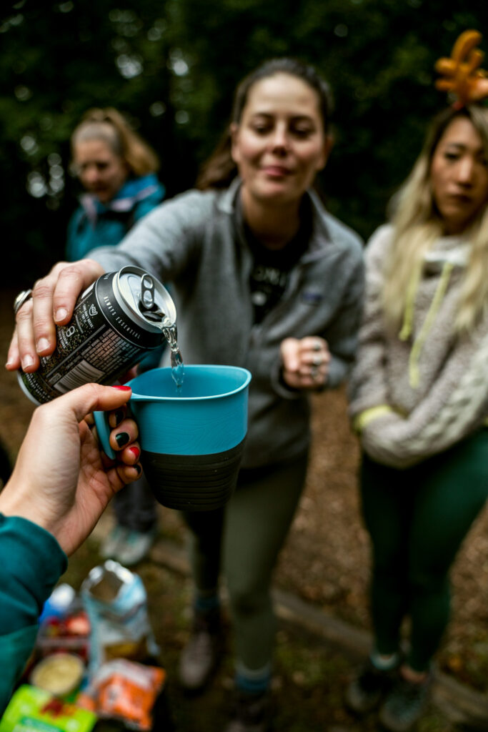 Pouring backcountry cocktail into UCO Camp Cup